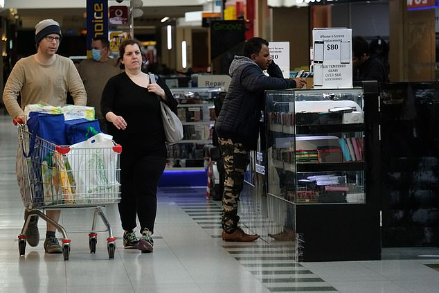 The buyers are seen with full trolleys as they make their way around Brimbank Shopping Centre on Tuesday