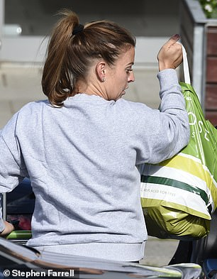 Groceries: The star was seen loading her groceries into the boot of her car