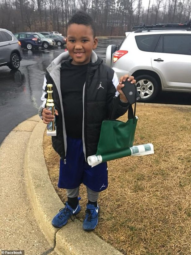 Nine-year-old Dallas is photographed in a social media capture shared by his mother, Marcia Grant.