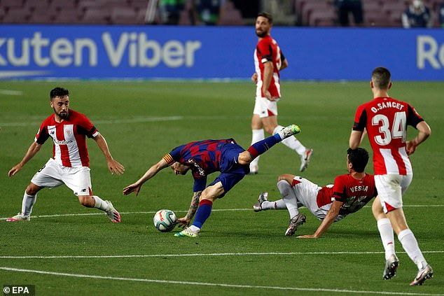 The Barcelona forward takes a tumble following a challenge by Athletic's Mikel Vesga