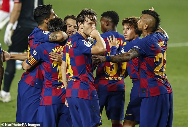 Ivan Rakitic (middle) scored his first goal of the season to keep Barcelona's title hopes alive