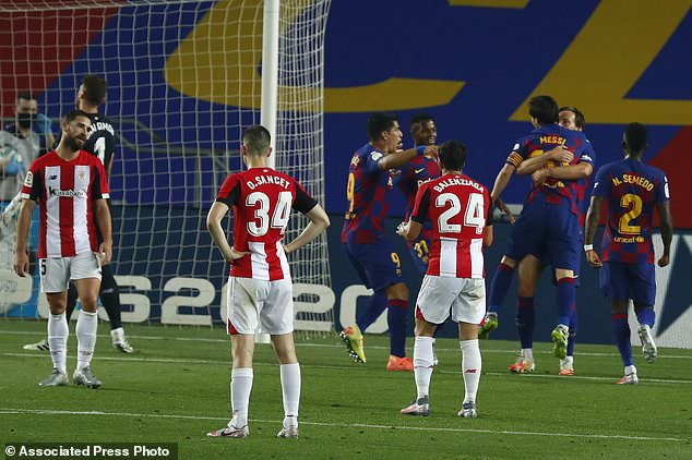 Barcelona's Ivan Rakitic, second right, celebrates with his teammate Lionel Messi after scoring the opening goal during the Spanish La Liga soccer match between FC Barcelona and Athletic Bilbao at the Camp Nou stadium in Barcelona, Spain, Tuesday, June 23, 2020. (AP Photo/Joan Monfort)