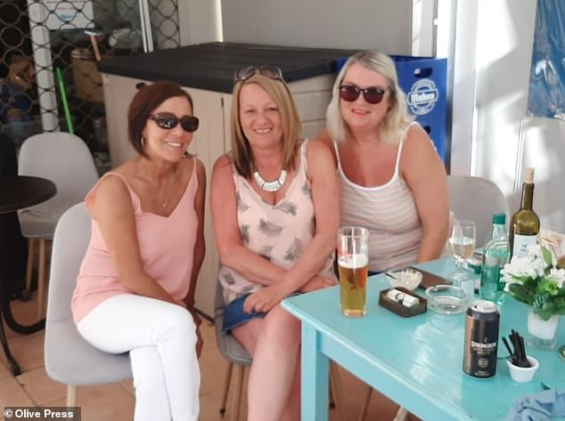 Julie Balai, 61 (center), Sylvia Riley, 60 (left), and Andrea Harrison, 59 (right), boarded a Ryanair flight to Benidorm at 9 a.m. on Sunday - the day of reopening of borders - and say they got from the resort