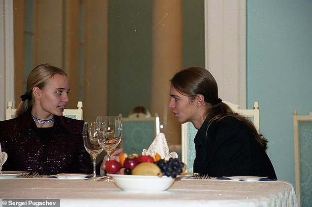 Maria Putina and Viktor Pugachev chat during a private party at former Putin crony Sergei Pugachev's country house