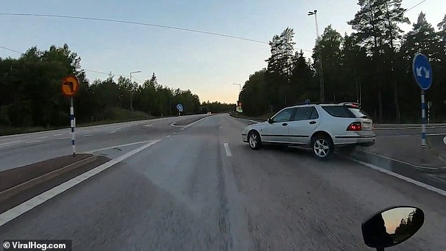 The car then dramatically spins ninety degrees into the road, right into the path of the rider