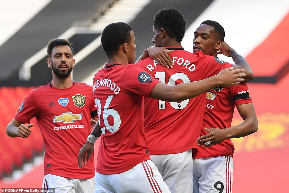 Martial is congratulated by Marcus Rashford and Mason Greenwood after netting in just the seventh minute of the game