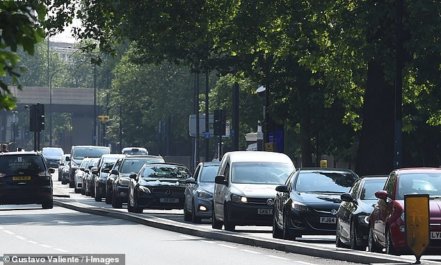 Cars queue on the busy New Kent Road in London's Southwark today as congestion levels rise