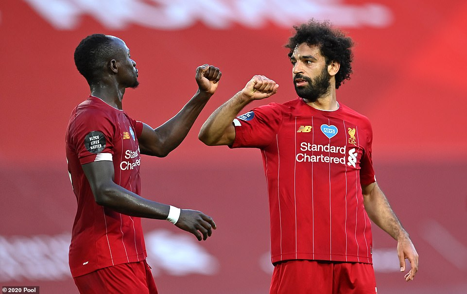 Salah (right) responded to the instructions and finished off a brilliant move before a socially-distanced celebration with Mane
