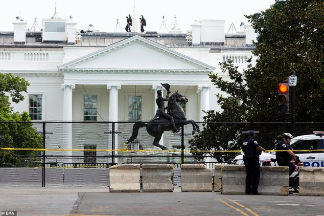 The view of a fence put up around closed-off Lafayette Park across the street from the White House on Wednesday