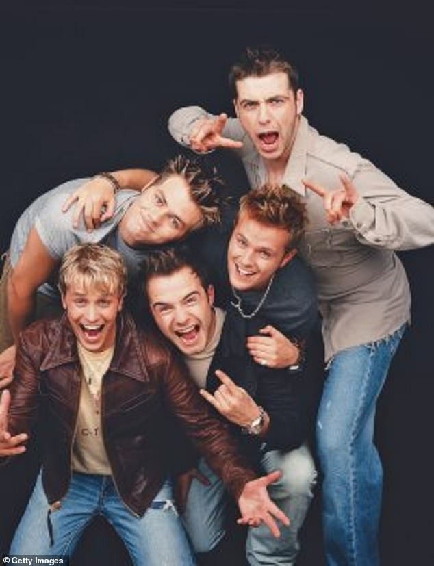 Way back when: Brian left Westlife fans in shock when he departed the band in 2004 before later joining supergroup Boyzlife in 2016 (Westlife, pictured in 2000)