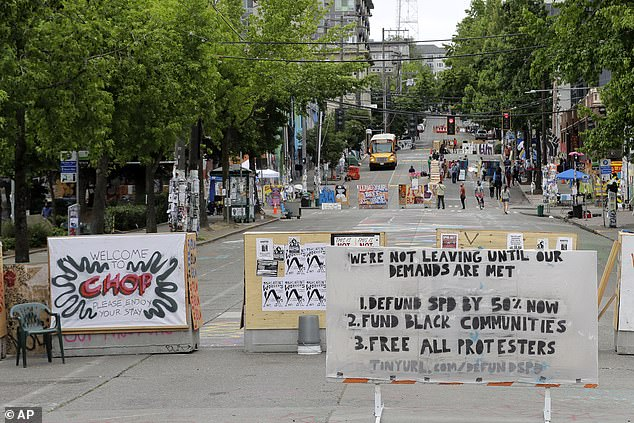 Pictured: A sign on the street welcomes visitors and a list of demands is posted Wednesday, June 24, 2020, inside the CHOP (Capitol Hill Occupied Protest) zone in Seattle