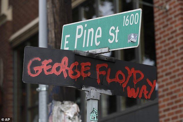 "Pictured: A street sign at the intersection of 11th Ave. and Pine St. has been changed to read ""George Floyd Way,"" Wednesday, June 24, 2020, inside the CHOP (Capitol Hill Occupied Protest) zone in Seattle"