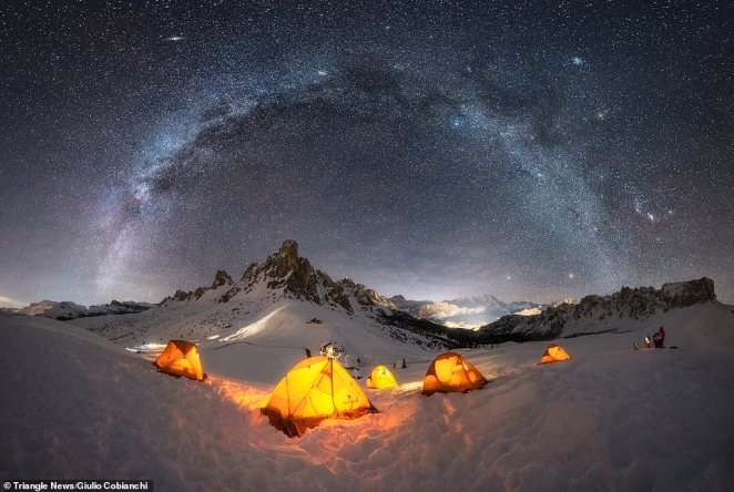 'Base Camp' by Giulio Cobianchi.Dolomites – Italy. Cobianchi said he shoots the Milky Way 12 months of the year but especially loves capturing shots during the winter season. He said: 'It fascinates me even more, probably because the Milky Way has cooler colours that combine perfectly with the snow, and also because shooting under these conditions is much more challenging'