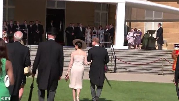 After a brief conversation with the Prince of Wales, the Duke and Duchess of Sussex could be seen walking away from the party towards the palace.
