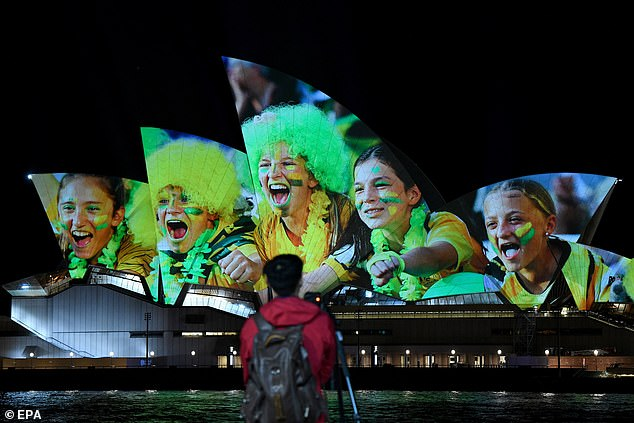 The Sydney Opera House and Auckland's Sky Tower were lit up on Thursday to celebrate the joint bid