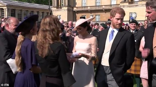 Prince Harry was called in by a man who appears to be a staff member, before the Duke continues to speak to Prince Charles.