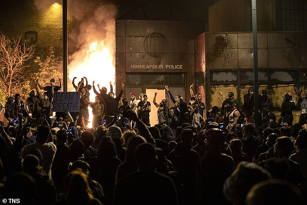 A massive crowd of protesters denouncing police brutality gathered outside the Third Police Precinct and set it on fire on the third night of George Floyd protests on May 28