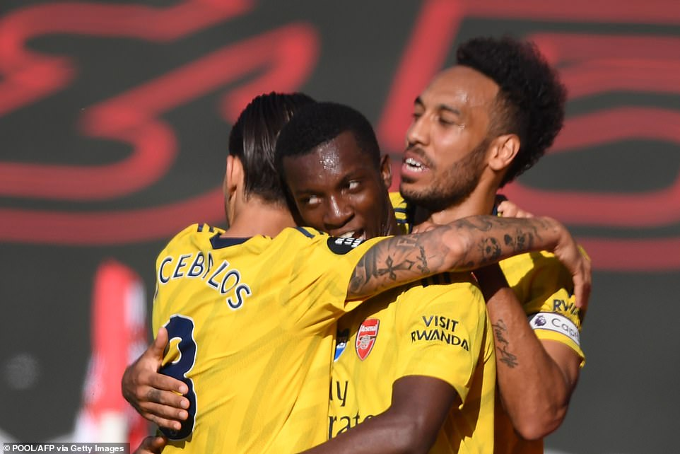 Nketiah is congratulated by his Arsenal team-mates Dani Ceballos and Pierre-Emerick Aubameyang after he found the net