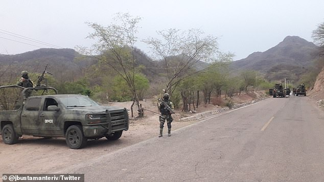 Soldiers guard the perimeter where seven men were killed Wednesday due to an internal conflict between ruling members of the Sinaloa Cartel