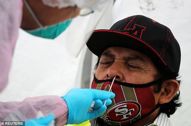 XPO Logistics truck driver Jose Lopez, 64, is tested for COVID-19 at an International Brotherhood of Teamsters testing site, as the spread of the coronavirus disease (COVID-19) continues, in Wilmington, near the Port of Los Angeles, California, U.S., June 25, 2020