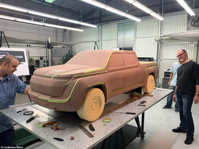 Designers are seen working with a clay model of the new Endurance pickup