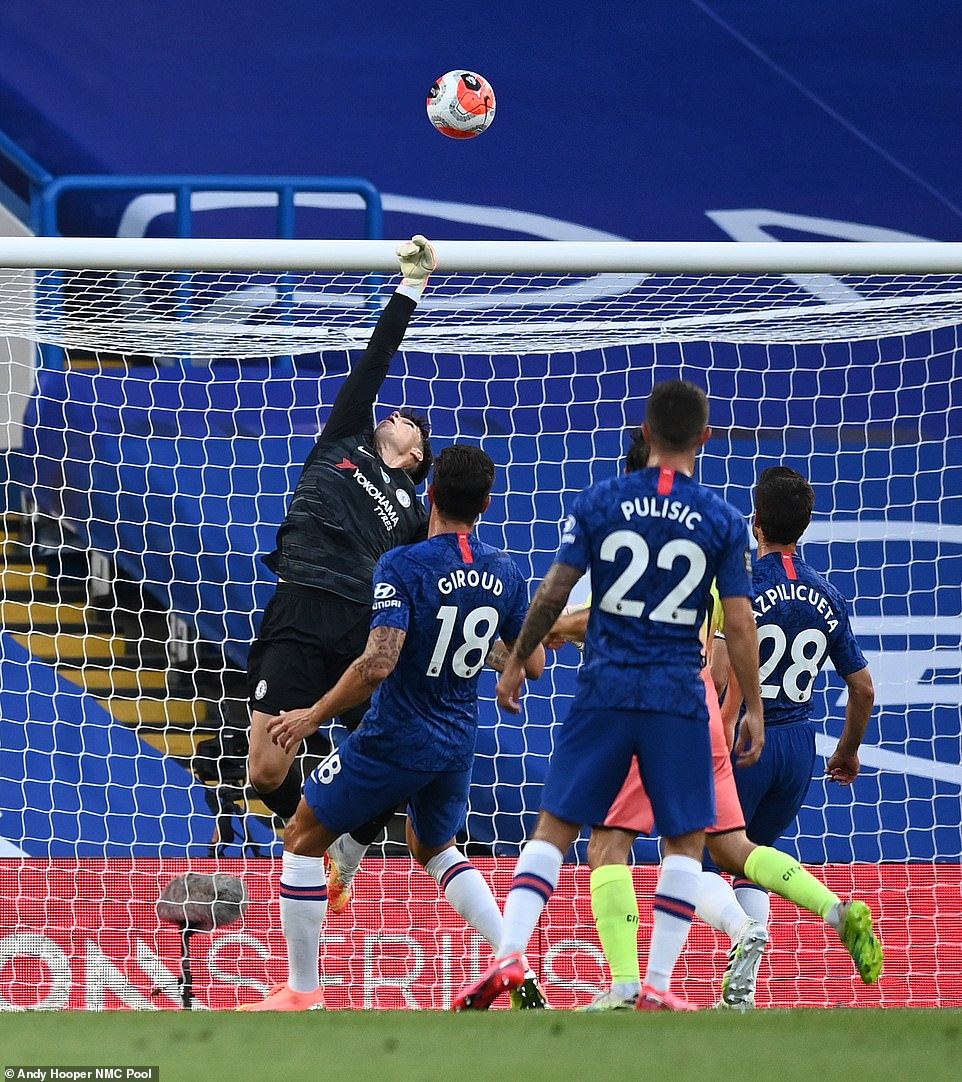 Chelsea goalkeeper Kepa does well to turn the ball over the bar after a flick towards his goal as City piled on the pressure
