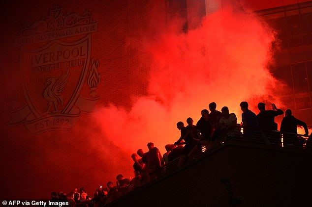 Flares were set off as fans took any vantage point they could to drink in the atmosphere