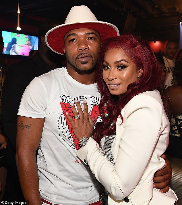 Fayne (pictured with Karlie Redd, right) is charged with allegedly using coronavirus Paycheck Protection Program loan money to buy things including a Rolex and pay past due child support