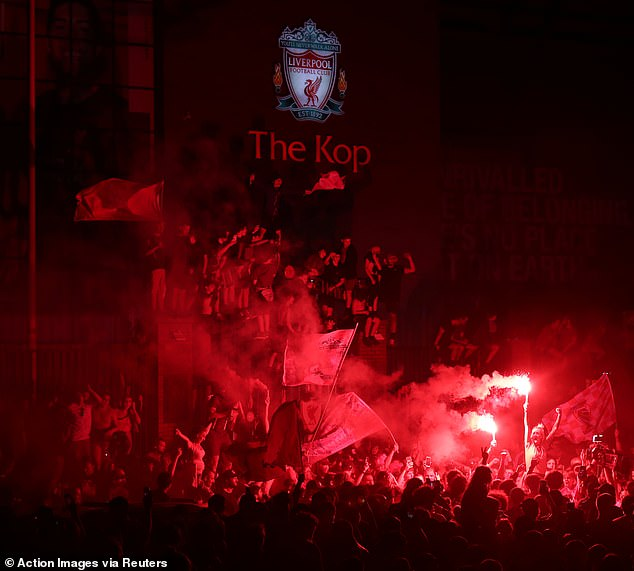 Anfield was submerged by red smoke as fans marked a momentous day for the city and club