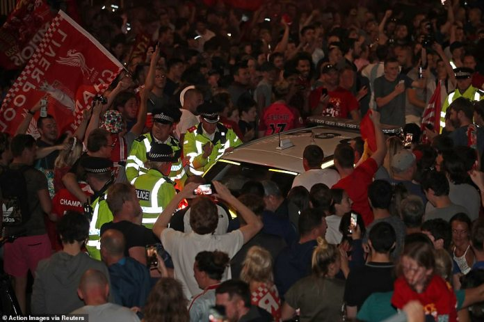 Police officers are surrounded by thousands of celebrating Liverpool fans, though the huge crowd remained peaceful throughout
