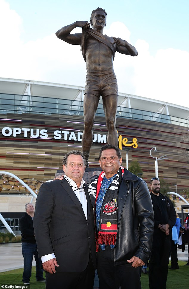 Photographer Wayne Ludbey poses with Nicky Winmar during the Nicky Winmar statue unveiling at Optus Stadium in Perth last year