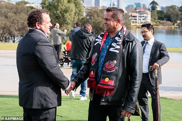 Former St Kilda Saints player and Western Australian-born Noongar man, Nicky Winmar (right) speaks with photographer Wayne Ludbey before the unveiling of his statue at Optus Stadium in Perth last year