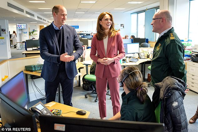 Prince William and Kate Middleton with London Ambulance Service CEO Garrett Emmerson chat with staff during a visit to the London Ambulance Service 111 control room in Croydon, March 19, 2020