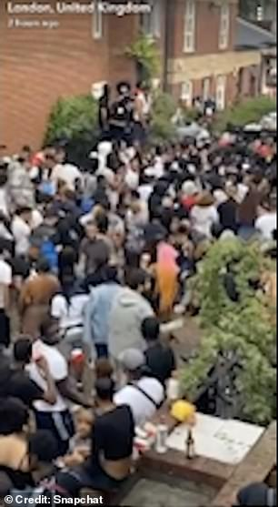 Video footage shows large party in West Kilburn as police fought revelers with shields and batons while loud music sounded