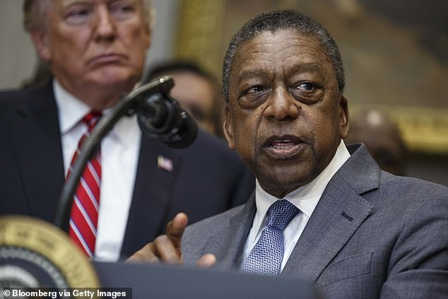 Johnson speaks during an executive order signing in the Roosevelt Room of the White House in Washington DC.Johnson, who was the first black American billionaire, said his proposal for reparations to be paid to US descendants of slaves would be 'a huge emotional assuaging of guilt for black and white Americans'