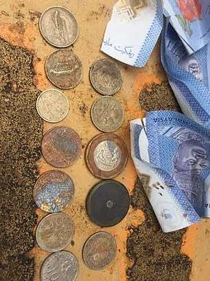 A mix of Malaysian and Australian coins were also reportedly found on the worksite (pictured)