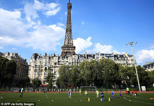 France (in the photo, children playing football near the Eiffel Tower on Thursday) said the epidemic was