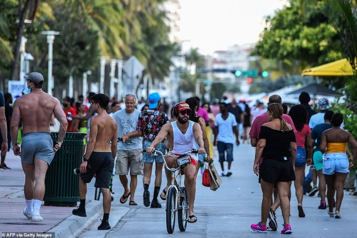 FLORIDA: Miami residents travel to Ocean Drive on Friday amid an outbreak of coronavirus cases