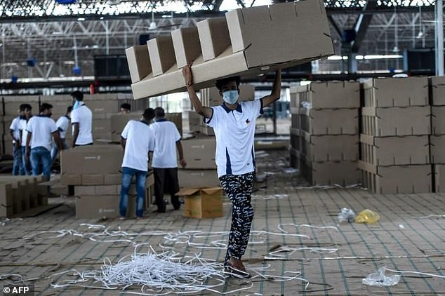 India deploys thousands of cardboard beds in makeshift medical facilities as it struggles to cope with rising coronavirus cases