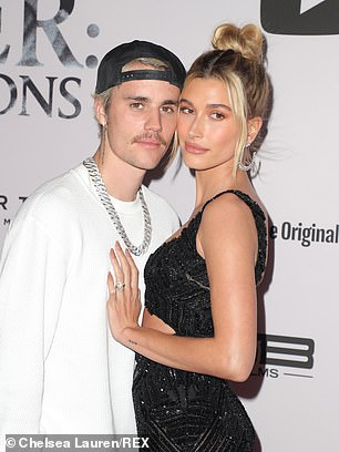 On Monday, after taking the time to consult his photographed wife Hailey and `` his team, '' Bieber posted a series of tweets denying the allegations of assault against him and threatening to prosecute his accusers.