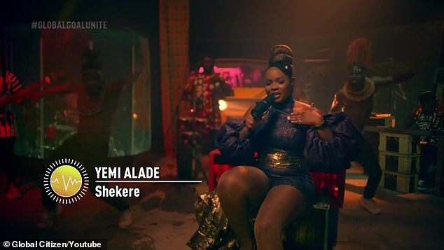Party atmosphere: Yemi was joined by a group of backup musicians and dancers on a Lagos ensemble designed to resemble a parking lot at night