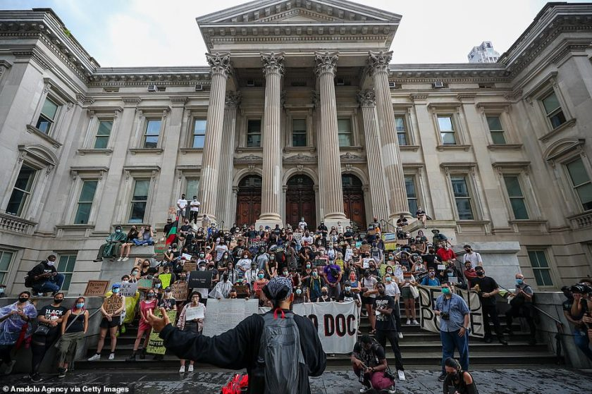 Protesters sit at the stairs of Tweed Courthouse as hundreds congregate at the New York City Hall as part of the 'Defund NYPD' and 'Occupy City Hall' movement. The encampment is now in its fifth straight day of camping outside the building