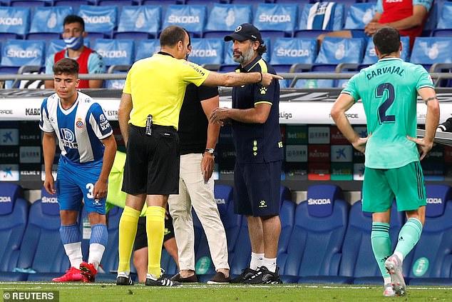 Espanyol coach Francisco Rufete disputes a decision with referee Antonio Lahoz