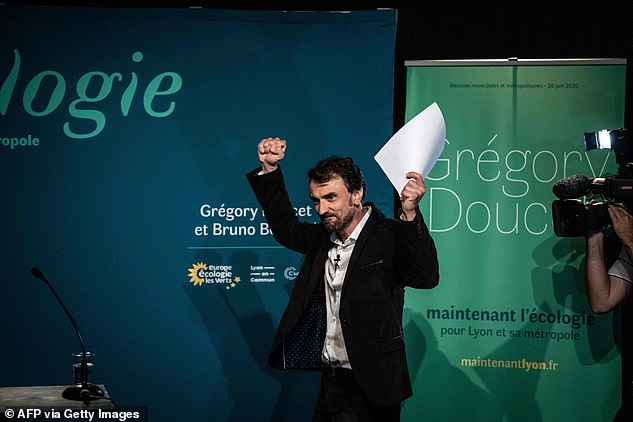 French EELV (Europe Ecologie Les Verts) green party candidate for Lyon's mayor Gregory Doucet raises his fist before delivering a speech, on June 28, 2020 in Lyon, following his victory after the second round of the mayoral election