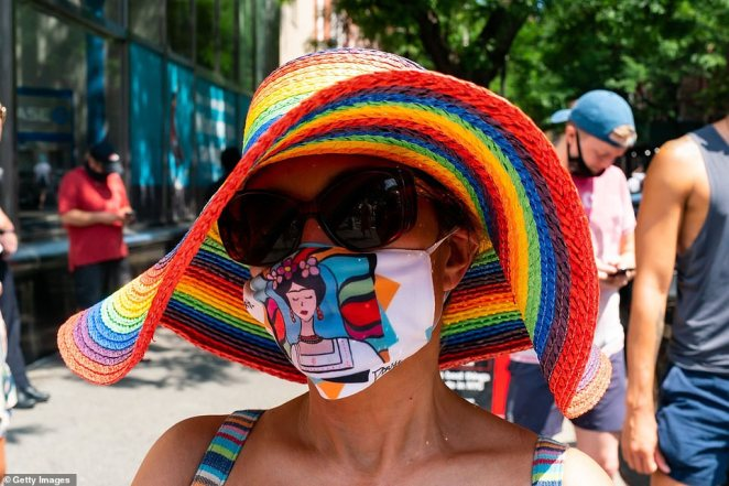 A woman on Sunday shows her support for the cause in a colorful hat and Frida Kahlo mask