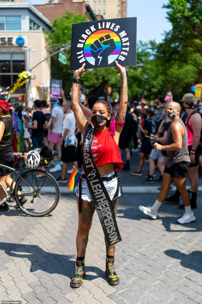 Jay Walker, one of the organizers, said:'We're just standing here arm-and-arm with black folks, black trans folks, with brown folks, everybody that is under the boot of the police ¿ not just NYPD ¿ all over this country.'
