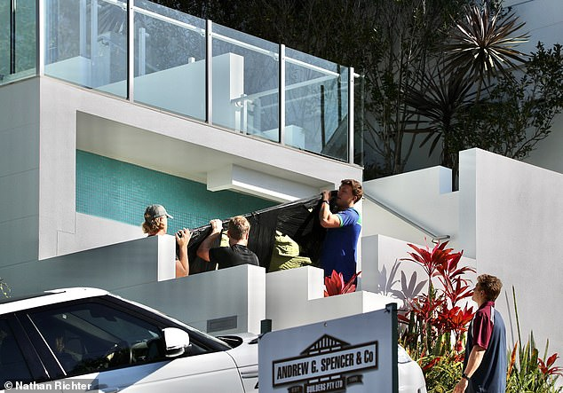 Helping hand: With Today Show host Karl, 45, remaining in Sydney for work commitments, the show designer relied on the help of movers as she attempted to settle into the new pad