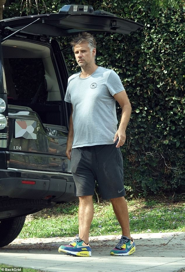 Moving day: Richard Bacon, 44, didn't have far to travel as he moved his belongings just 300 metres from his old home to the new one in the Hollywood Hills on Sunday