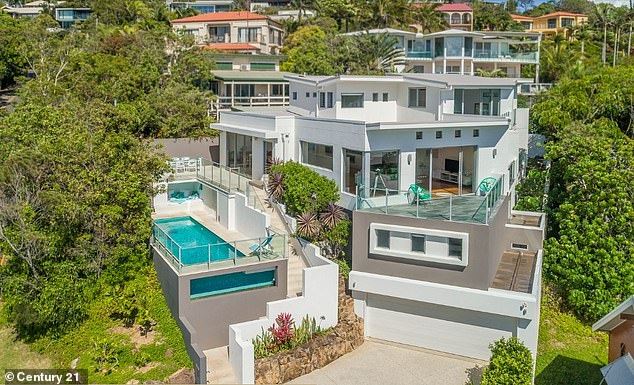 Room with a view: The expansive house overlooks Sunshine Beach and has four bedrooms, four bathrooms, a three-car garage and a swimming pool