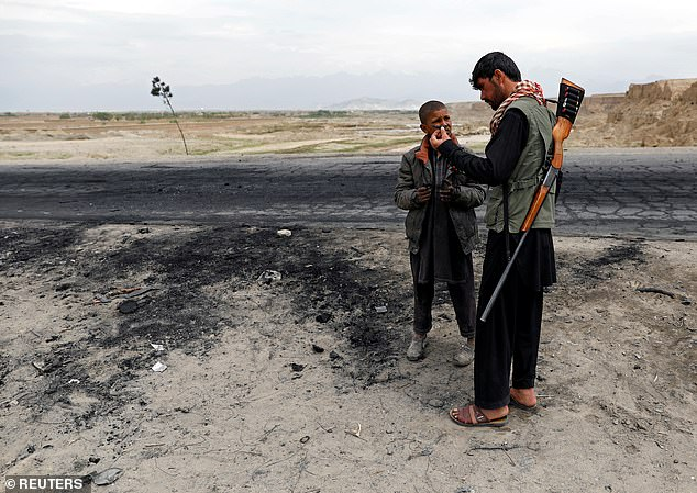 Officials said the intelligence community has been investigating the April 2019 attack on an American convoy that killed three US Marines and wounded three other US service members and an Afghan contractor after a car was rigged with explosives and detonated near their armored vehicles, to see if it could be potentially linked to the Russian bounties. The site of the car bomb above on April 9, 2019